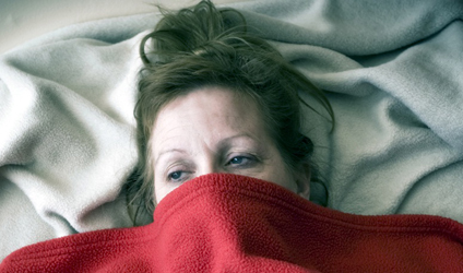 Photographie d'une femme d'apparence malade.