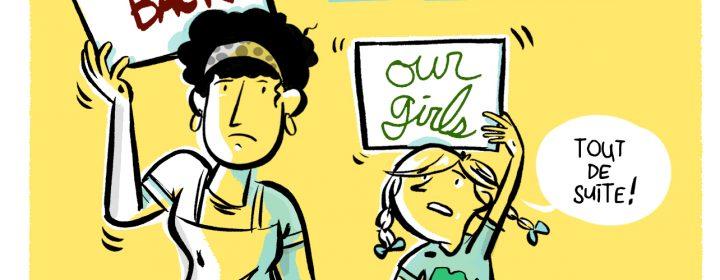 Une femme et sa fille avec l'affiche Bring Back our girls.